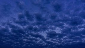 Dark blue sunset clouds time lapse stock video footage