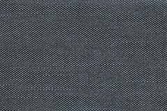 Dark blue textile background with checkered pattern, closeup. Structure of the fabric macro. Stock Photos