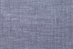 Dark blue textile background with checkered pattern, closeup. Structure of the fabric macro. Royalty Free Stock Image