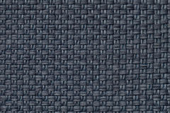 Dark blue textile background with checkered pattern, closeup. Structure of the fabric macro. Stock Images