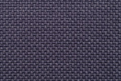 Dark blue textile background with checkered pattern, closeup. Structure of the fabric macro. Stock Photo