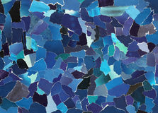 Dark blue texture of torn paper. Dark blue texture made from many pieces of torn paper royalty free stock photos