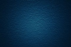 Dark blue tone background with patterned and textured concrete wall surface. For wallpapers and space royalty free stock photography