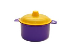 Dark blue toy pan with a yellow cover Royalty Free Stock Photos