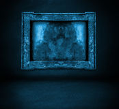 Dark blue wall with frame and floor interior Stock Image