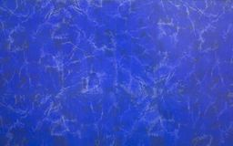 Dark blue wall surface with white and black spots of mildew and dirt. rough texture stock photo