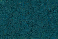 Dark blue wavy background from a textile material. Fabric with fold texture closeup. Royalty Free Stock Image
