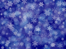 Dark blue winter background with snowflakes and boke royalty free stock photos