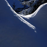 Dark blue winter snow pile shadows Royalty Free Stock Photography