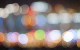 Dark blurred background of night city lights Stock Photos