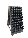 Dark bottles on a wine cellar wooden support isolated over white Royalty Free Stock Photos