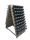 Dark bottles on a wine cellar wooden support isolated over white Stock Image