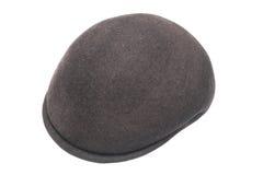 Dark braided cap over white Royalty Free Stock Photo