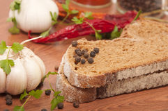 Dark Bread And Spices Stock Photos