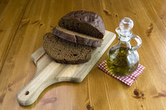 Dark bread and olive oil. Royalty Free Stock Photo