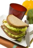 Dark bread sandwich with standing fork, isolated Royalty Free Stock Image