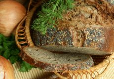 Dark bread with seeds and with poppy Royalty Free Stock Image