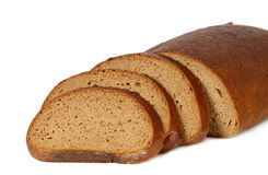 Dark bread with some sliced pieces Royalty Free Stock Photography
