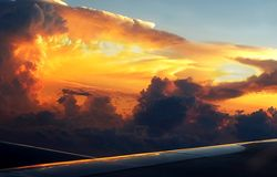 Dark Brewing Thunderstorm Cloud At Dusk. As seen from aircraft window Stock Images