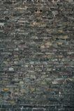 Dark brick wall background. With various names scratched on it. Different languages - english, russian Royalty Free Stock Photography