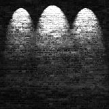 Dark brick wall background in basement with beams of light. Black and white version vector illustration