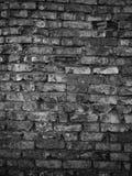 Dark brick wall background Stock Images