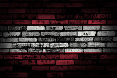 Dark brick wall backround or texture with blending  Austria flag Royalty Free Stock Images