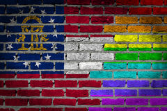 Dark brick wall - LGBT rights - Georgia. Dark brick wall texture - coutry flag and rainbow flag painted on wall - Georgia Royalty Free Stock Photo