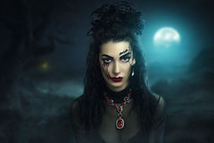 Dark bride. Young beautiful girl woman lady witch black bride widow. Night cemetery forest background darkness death. Bright fantasy makeup red lips blood royalty free stock photography