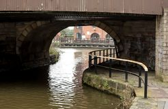 Dark Bridge near Wigan Pier. The view under a dark bridge near Wigan Pier on the Leeds Liverpool canal Royalty Free Stock Photo