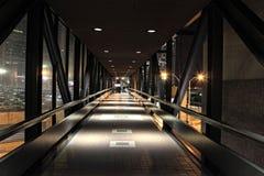 Dark Bridge to Parking Deck. Image of a dark bridge to a city parking deck Royalty Free Stock Image
