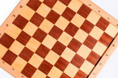 Dark and bright squares of a wooden chess board Royalty Free Stock Photos