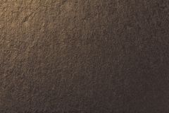 Dark bronze background of natural slate. Texture of brown stone stock photography