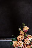 Dark brown background with beautiful rose flowers Royalty Free Stock Photos