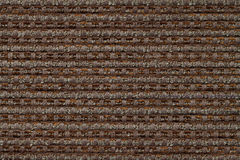 Dark brown background from checkered pattern textile, closeup. Structure of the wicker fabric macro. Dark brown background from checkered pattern textile stock images