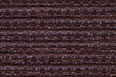 Dark brown background from checkered pattern textile, closeup. Structure of the wicker fabric macro. Dark brown background from checkered pattern textile stock photo