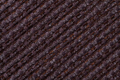 Dark brown background from checkered pattern textile, closeup. Structure of the wicker fabric macro. Dark brown background from checkered pattern textile royalty free stock image