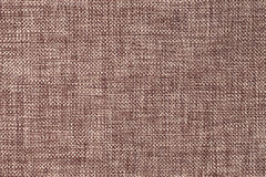 Dark brown background of dense woven bagging fabric, closeup. Structure of the textile macro. royalty free stock image