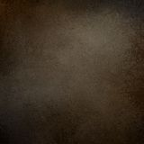 Dark brown background with grainy rough textured grunge border Stock Photography