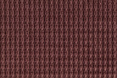 Dark brown background from soft fleecy fabric close up. Texture of textiles macro Stock Photography