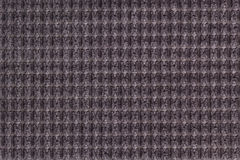 Dark brown background from soft fleecy fabric close up. Texture of textiles macro Stock Image