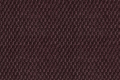 Dark brown background from soft fleecy fabric closeup. Texture of textile macro Royalty Free Stock Images