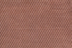 Dark brown background from soft fleecy fabric closeup. Texture of textile macro Stock Image