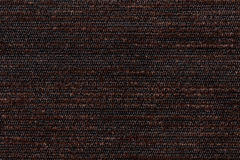 Dark brown background from soft textile material. Fabric with natural texture. Royalty Free Stock Photos