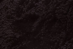 Dark brown background from a soft upholstery textile material, closeup. Stock Image