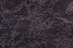 Dark brown background from a soft upholstery textile material, closeup. Stock Photo