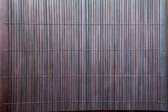 Dark brown Bamboo mat tablecloth background texture Royalty Free Stock Photos