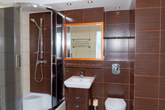 Dark brown bathroom interior. Modern bathroom interior in dark brown color royalty free stock images