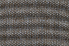 Dark brown and blue background of dense woven bagging fabric, closeup. Structure of the textile macro. Stock Image