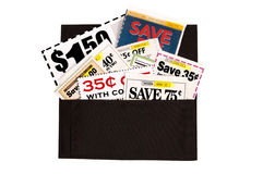 A Dark Brown Cloth Wallet Full of Coupons. Of various values Royalty Free Stock Photography